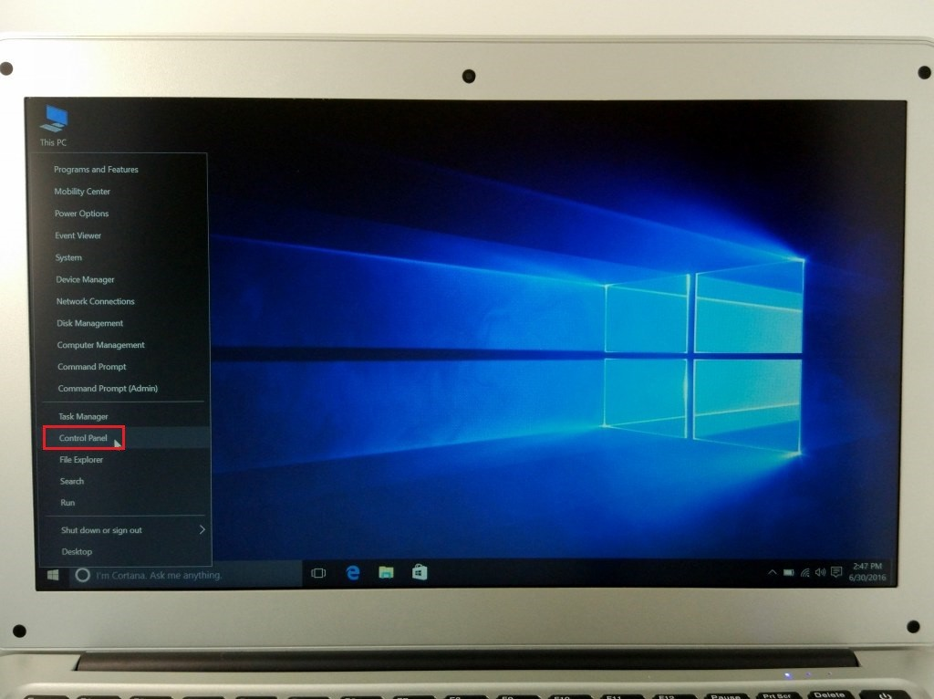 左したのWindowsアイコンを右クリックしてControl panelを選択